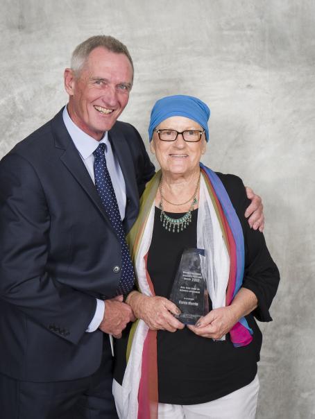 Consumer Protection Award 2017 winner Karen Merrin with Commissioner David Hillyard.jpg