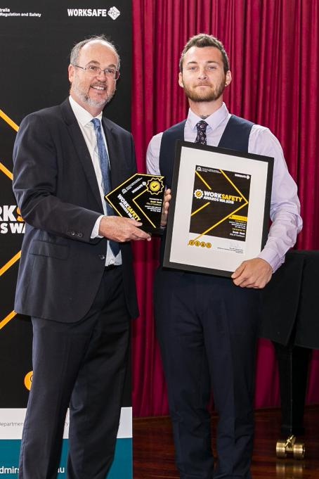 Scott Hunt, City of Cockburn - Safety and health representative of the year, receiving his award from Minister Bill Johnston