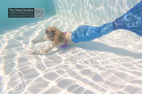 Lauren Thomas (Perth model) using a mermaid tail.
